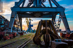 Industrial crane at the port. Dock for loading of scrap metal Stock Photo