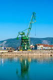Industrial crane in river harbor. With clear blue sky and river Royalty Free Stock Photography