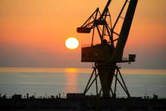 Industrial crane at sunrise Royalty Free Stock Photos