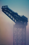 Industrial Crane At Sunrise In The Fog Stock Image