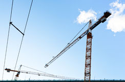 Industrial crane under blue sky Stock Images