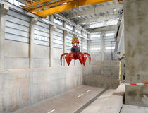Industrial crane in a waste depot hall Royalty Free Stock Image