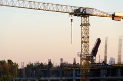 Industrial cranes building in the city Royalty Free Stock Photo