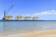 Industrial cranes and cargo on port Stock Photo