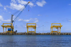 Industrial cranes and cargo on port Royalty Free Stock Photo