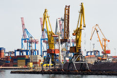 Industrial cranes and cargo on a quay Stock Images