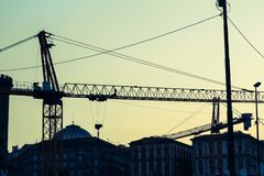Industrial cranes in the center of Naples Royalty Free Stock Photo