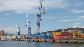 Industrial cranes and containers in harbor. stock video footage