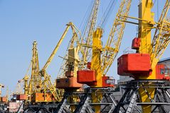 Industrial cranes on dock Royalty Free Stock Image