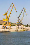 Industrial cranes in harbor Royalty Free Stock Photo