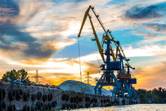 Industrial cranes at the port. Dock for loading of scrap metal stock photography