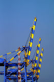 Industrial cranes in the sea port of Kochi Stock Photography