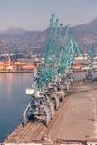 Industrial cranes in seaport Stock Photos
