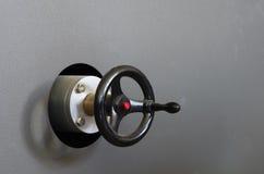 Industrial Crank. Heavy duty industrial crank on a textured gray metal machine Stock Photos