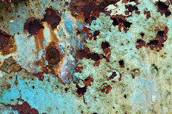 Industrial Decay. Paint and rust flake off an old piece of abandoned farm equipment Stock Images
