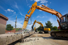 Industrial Demolition. Commercial and Industrial Demolition with Hydraulic Crushing Hammers Royalty Free Stock Photography