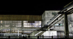 Industrial detail of a factory at night. Detail of a factory at night Stock Photography
