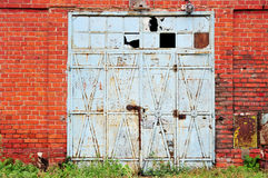 Industrial detail with old warehouse gate Royalty Free Stock Photo