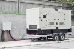 Industrial Diesel Generator. Standby generator. Industrial Diesel Generator for Office Building connected to the Control Panel royalty free stock photos