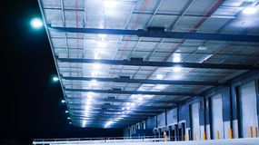 Expansive logistics distribution warehouse. Industrial distribution centre at night time in an industrial park royalty free stock photography