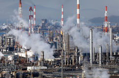 Industrial district. Chemical manufacturing plant with pollution Stock Images