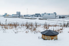 Industrial district on the bay in winter scene. Industrial district on the shore of the Gulf of Finland in winter scene Stock Photography