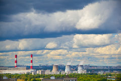 Industrial district, fuming industrial chimney. Royalty Free Stock Photo