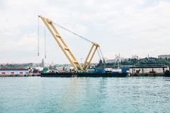 Industrial dock with loading and unloading of sea transport on the Bosporus in Istanbul, Turkey. Transportation, storage Royalty Free Stock Image