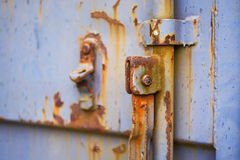 Industrial door in close-up. Close up of a rusty industrial shack Stock Photos