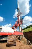 Industrial drilling rig at construction site making holes Royalty Free Stock Images