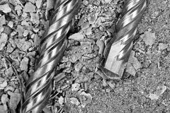 Industrial drills. On cracked concrete. Close-up view Royalty Free Stock Photos