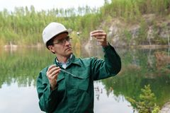 Free Industrial Ecologist Visually Evaluates The Response Of A Water Sample From Lake At The Site Of A Flooded Quarry Stock Images - 156926884