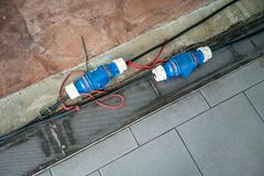 Industrial electric power safety plugs in construction building. Site royalty free stock photo