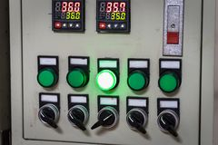 Industrial, electric switch panel with buttons in different colours.  stock image