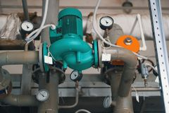 Industrial electrical air compressor. Manufacturing equipment stock images