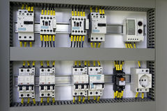 Industrial electrical equipment. Industrial enclosure with electrical equipment: miniature circuit breakers, contactors, switches, relay, socket and thermostat royalty free stock images