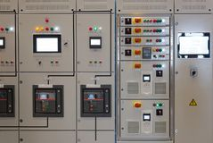 Industrial electrical switch panel. In control room of factory stock photography
