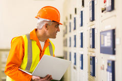 Industrial electrician working Stock Photos