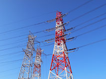 Industrial electricity pylons. Over clear blue sky Stock Photography