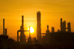 Industrial en puesta del sol Imagenes de archivo