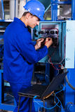 Industrial engineer repairing Stock Images
