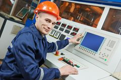 Industrial engineer worker at control panel stock photo