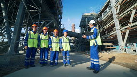 Industrial engineer and workers discussing in factory stock video footage