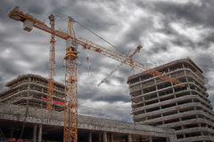 Free Industrial Engineering. Construction Crane On The Construction Site Against The Background Of New Real Estate Buildings. Royalty Free Stock Image - 96603756