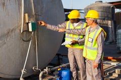 Industrial engineers inspecting stock photos