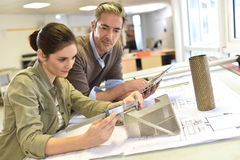 Industrial engineers workking on a project stock photography