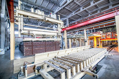 Industrial equipment at the factory in a large production hall Royalty Free Stock Image