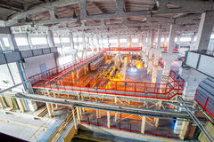 Industrial equipment at the factory in large  production hall Stock Image