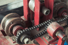 Industrial equipment fragment with chain belt. Industrial equipment, close up fragment with chain belt royalty free stock image