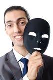 Industrial espionage concept - masked businessman Stock Photos